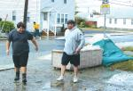 Damp but determined, downtown resort residents waste no time clearing homes