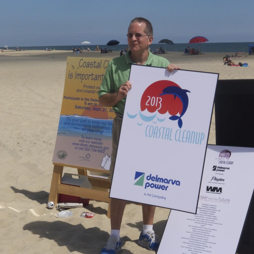 Delmarva Power's Matt Likovich holds up the 2013 Coastal Cleanup T-shirt design at the kickoff event in Ocean City Sept 4. Volunteers will get a free T-shirt for participating in the trash pick-up in Ocean City this Saturday. (Clara Vaughn)