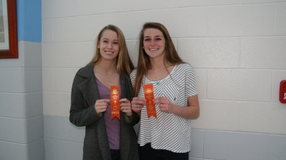 Two track athletes score ribbons
