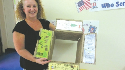 Elementary school students decorate boxes for troops