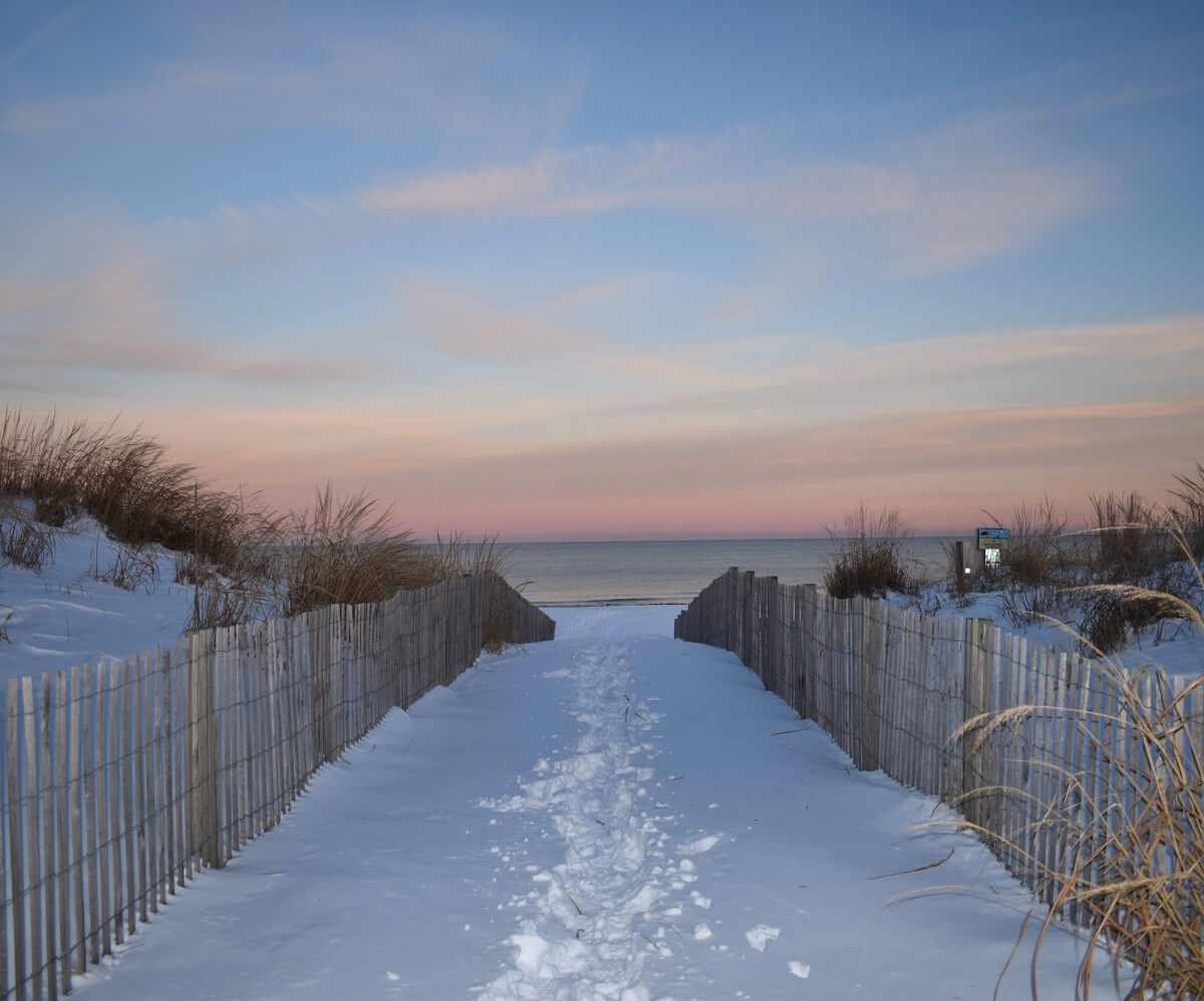 Snowy beach sunset
